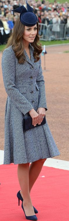 Kate Middleton wore a blue and white tweed Michael Kors Spring 2014 coat dress.    http://www.dailymail.co.uk/femail/article-2610954/Kates-38-000-Royal-Australian-tour-wardrobe-Including-7-000-red-coat-dress-35-recycled-frock-THOSE-wedges-plenty-Alexander-McQueen.html
