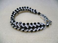 Flat Spiral Black White fold over rhinestone magnetic clasp silver beaded bracelet
