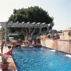 Simply Overhead        A weathered wood pergola works well with a variety of pool styles. The structure visually connects the pool's sides and provides shade for alfresco dining. The in-pool table adds a space to sip and soak.