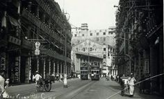 Des Voeux Rd,Central in Hong Kong in the 1930s.The Sun Company 大新公司  with the tower can be seen in the distance.Wing On Department Store,Sheung Wan (1907-c.1975).