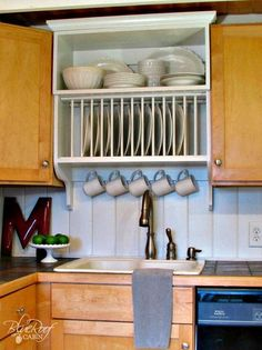 blue roof cabin: Update a Builder Grade Kitchen with a DIY Custom Cabinet Clever Kitchen Storage, Kitchen Shelves, Kitchen Redo, Kitchen Remodel, Kitchen Cabinets, Blue Cabinets, Open Shelves, Kitchen Ideas, Wooden Plate Rack