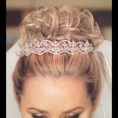 Beautiful Bridal Tiara With Comb Attachment Silver Bridal tiara with comb attachment and white crystals.  I also have many NWT name brand dresses as well as some store samples at very reasonable prices. When you purchase any two or more items from my closet I offer a 10% discount & you only pay once for shipping! Jewelry