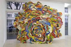 Jonathan Callan's Mesmerizing Organic Book Sculptures Are Swirling Masses of Color