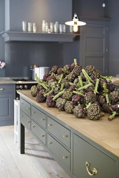 """I love the artichokes!! The island is painted in """"Dripping Tap."""" Plain English is a traditional joinery company. We use the techniques of 18th and 19th century cabinetmakers."""