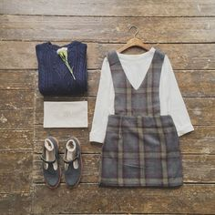 """""""Keeping it navy. Roll up loose fit tee, check apron dress, olive makeup bag and pom pom detail jumper. Online and in store now. #olive #oliveclothing…"""""""