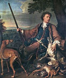 Artist François Desportes in hunting costume. His blue waistcoat has wide buttonholes, and he wears his own hair for outdoor activity. Self-...