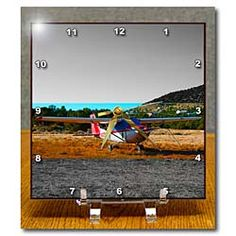 An Airplane in a field in Central Utah done in layers Desk Clock