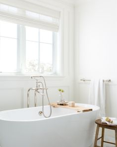 Sometimes the simplest things are the most luxurious. Get the look at theshadestore.com. // Design by Jenn Feldman Design // Photo by Amy Bartlam Shower Accent Tile, Shower Floor Tile, Glass Shower, Brown Bathroom, Master Bathroom, Bathroom Spa, Bathroom Ideas, Small Luxury Bathrooms, White Beveled Subway Tile