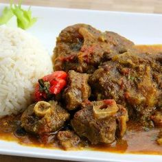 Ultimate Curry Oxtail The Ultimate Curry Oxtail Recipe.The Ultimate Curry Oxtail Recipe. Jamaican Cuisine, Jamaican Dishes, Jamaican Recipes, Curry Recipes, Haitian Recipes, Jamaican Oxtail, Jamaican Roti Recipe, Guyanese Recipes, Gastronomia