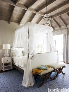 You'll really feel like you're floating on a cloud on this bed. In a Georgia beach house, the master bedroom's tall four-poster campaign-style bed soars toward the distressed oak ceiling and gives scale to the room. Click through for more stunning canopy ideas.