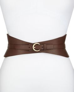 "Neiman Marcus leather corset belt. Approx. 4.25""W. Tapers at center. Adjustable strap with golden buckle. Imported."