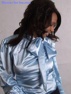 Dani in a spectacular blue satin tieneck blouse