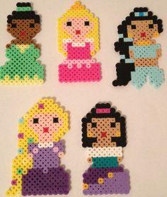 The Disney Princesses are made out of Perler Beads. These are my original perler bead designs. Items measures between Tiana Hama Disney, Hama Beads Disney, Perler Beads, Fuse Beads, Perler Patterns, Quilt Patterns, Disney Princess Set, Iron Beads, Beaded Cross Stitch
