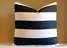 Making a statement on its own, this wide black and white striped pillow cover is simple and elegant. Single stripe measures 3 inches wide. Outdoor use