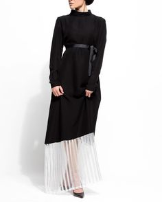 A beautiful tailored high neck abaya with broad white linear net border Shop Onyx Abayas by Aneesa Solomon at haute-elan.com