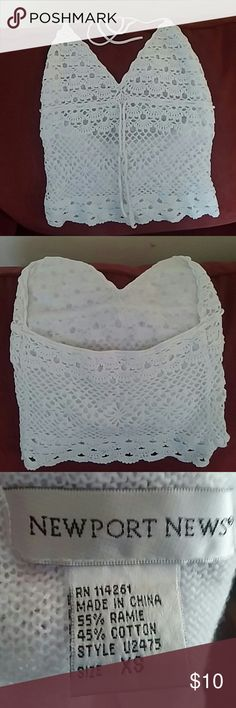 White crochet halter top Beautiful intricately crochet halter top. Lined with a thin knit material. 55% Ramie 45% cotton. Tag says XS but it runs bigger. Newport News Tops