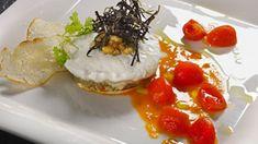 Parmigiana di ricciola, burrata e melanzane in salsa di pomodori pachino di Valentino Marcattilii