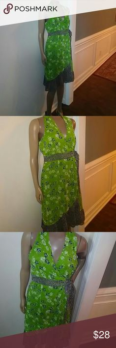 SALE MARKED DOWN DRESS..💃GREEN😃WRAP DRESS New with tag Beautiful designs...Wraps around the body and ties on the side...  My model is 5'7 inches  waist is 26 inches Jonathan Martin Dresses Midi