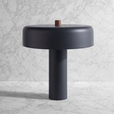 The Punk Table Lamp is a stunningly beautiful fixture made from steel. The perfect complement to the metal structure is the solid walnut switch cleverly place on top of the shade.
