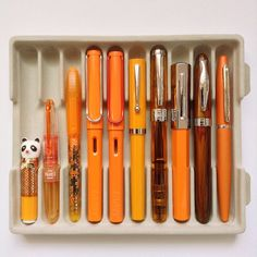 A tray of #fountainpen #happiness. And yes that panda is a fountain pen. #orange #PilotPetit #Schneider #LamySafari #Sheaffer No Nonsense… Antique Fountain Pens, Fountain Pen Ink, Cool Stationary, Calligraphy Ink, Pen Collection, Vintage Office, Penmanship, Writing Instruments, In Writing