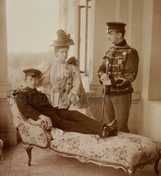 Prince Alfred of Edinburgh-Coburg, his sister Marie, Crown Princess of Romania and Grand Duke Boris Vladimirovitch of Russia.  I am guessing this was taken at the time of Nicholas II Coronation, where it was rumored that Marie had an affiar with Boris while her sister Victoria-Melita of Hesse had an affair with his brother Kyrill.  Victoria-Melita later divorced Ernst of Hesse and married Kyrill.