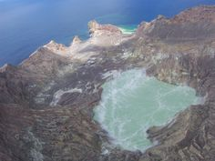 Looking down to the centre of the crater of White Island, NZ, from chopper