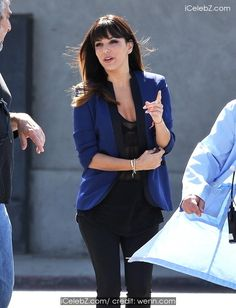Eva Longoria sporting new bangs spotted on the set of her new flick 'Visions' filming in downtown Los Angeles http://www.icelebz.com/events/eva_longoria_sporting_new_bangs_spotted_on_the_set_of_her_new_flick_visions_filming_in_downtown_los_angeles/photo2.html