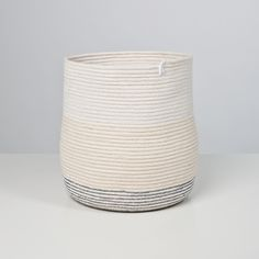 This vessel is made from 100 feet of #6 100% cotton cord that is coiled and stitched with sewing thread. The resulting textile is flexible but...