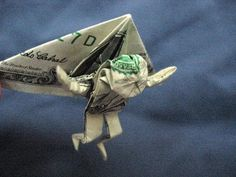 Dollar Bill Origami.  If the pin doesn't work, try this link: http://www.squidoo.com/dollar-origami