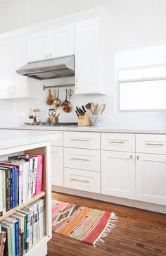 white kitchen with brass hardware