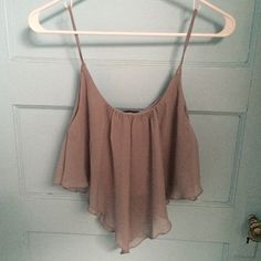 NWOT grey top super cute wet seal tank top!! never wore it its just been sitting in my closet. kind of cropped and longer in the front and back Wet Seal Tops Tank Tops