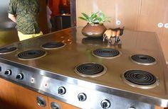 Gleaming 7 burner stainless range at the midcentury modern Liljestrand House.