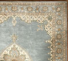 Mia Persina Style Rug from Pottery Barn. Maybe in the dining room?  Love the colors.  9'x12' for $899.00