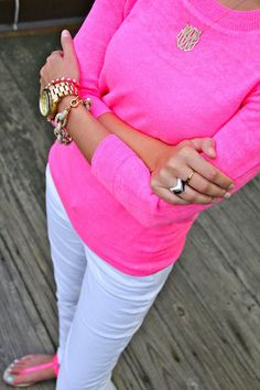 Love the sweater, white slacks, pink top, monogram jewelry and pink sandels.  The whole outfit is a hit!