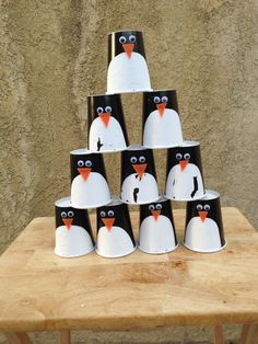 Party Like A Penguin: cups game- we forgot to take a pic BEFORE they went through a few rounds so the paint is a little cracked **we added some weight to the cups by gluing glass vase fillers to the inside (those can be found at dollar stores).