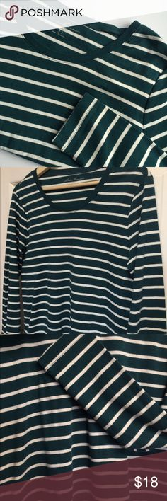 "Eddie Bauer Long sleeve green striped tee. Large EUC Green & white striped long sleeve tee. Very soft and in EUC 20"" from side to side underarm and 26"" sleeve length. Nice stretch! Thanks for visiting gigishanger 😊 Bundle for a greater discount Eddie Bauer Tops Tees - Long Sleeve"