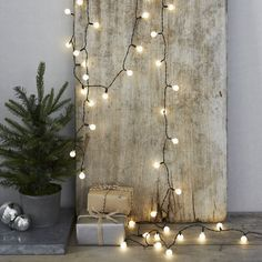 Create a festive feel in any room with these retro-style Winterberry fairy lights from The White Company. Featuring 50 white bulb-shaped fairy lights, instantly add a warm glow to your tree or simply drape around the home for added ambience. Christmas Makes, Christmas 2016, Christmas And New Year, White Christmas, Christmas Presents, Potted Christmas Trees, Christmas Fairy Lights, Decorating With Christmas Lights, Christmas Decorations Online