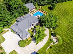 Executive home in Rivergreen Subdivision. This 4 bd/3.5 ba home offers a private retreat from everyday life. It features over 5000 sq. ft. plus a 1000 sq. ft. pool house on 1.83 acres. 2 kitchens, 2 bonus rooms, large L-shaped pool area, great room & living room, 2 screened-in porches that overlook nature. The pool house has a full kitchen, bath, great room for entertaining. This home is a must see!