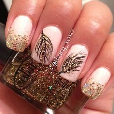 Fall themed nail art with gold glitter coupled with leaf details in black polish.