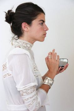 man repeller in clean whites and silver jewelry