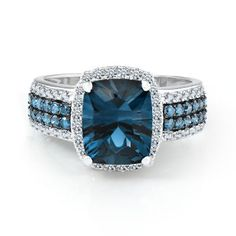 Blue Topaz And Diamond Ring