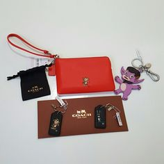 Coach Gary Baseman collection This is a wonderful collection of Coach items by artist Gary Baseman. These are all brand new with tags and unused! One red wristlet with red hang tag and with animal print monster on the front. One coach keychain of a purple monster with clip and ring and metal tag. Also two black hang tags with a grey blindfolded monster and Leopard print monster in the second. Collectable and super cute! Coach Bags Clutches & Wristlets