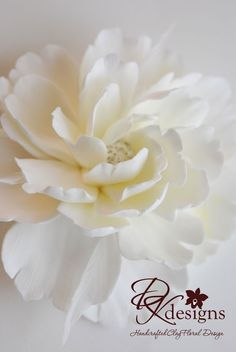 Could be made with gumpaste. Couture Clay - Made to Order Whitish Ivory Peony Hair Flower with Rhinestone Center and Feather Accents