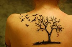 Love the tree design .. a couple ravens . and a red heart dangling from one of…
