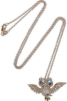 owl pendant is inlaid with 0.55-carats of pavé diamonds and finished with 0.50-carats of polished sky-blue moonstones.