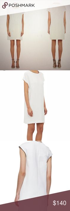 """NWT Vince Leather-Piped Crepe Shift Dress Exclusive to Barneys. Vince. Ivory pebbled crepe Shift dress trimmed at neckline with black leather piping. Jewel neckline. Zip back closure. Cap sleeves. Darting at bust. Side seam pockets. Acrylic/polyester. Style # 503871502. Approx measurements: 20.5"""" underarm to underarm flat across, 34.25"""" Length Vince Dresses"""