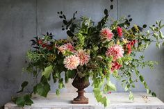 Grapes, dahlia 'Ice Cube', copper beech, rambling rose foliage, fennel, crabapples, rosehips, bells of ireland, teasel