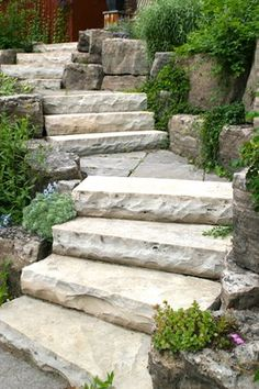Stone for front yard. Owen Sound natural stone slab steps and landings; armour boulders with planted gardens. More