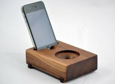 Acoustic Speaker Dock  This solid wood speaker doesn't use any electronics, amplifying sound acoustically through the shape of the wood.  Mini koo, $70 at Koostik.