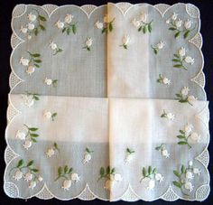 Cotton handkerchief featuring embroidered Lily of the Valley, which also represents a 2nd anniversary. (2nd wedding anniversary)